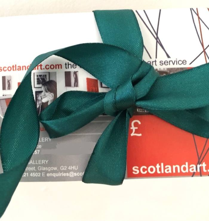 A gift voucher redeemable for art at Scotland Art gallery, presented wrapped with a bow.